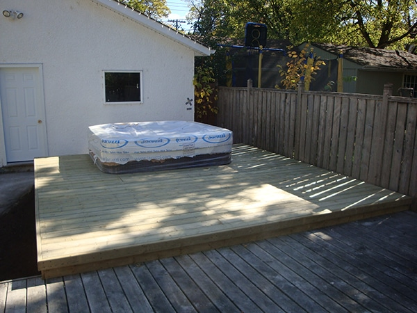 Hot tub pad and treated green deck added to existing deck (decks, hot tub pads)