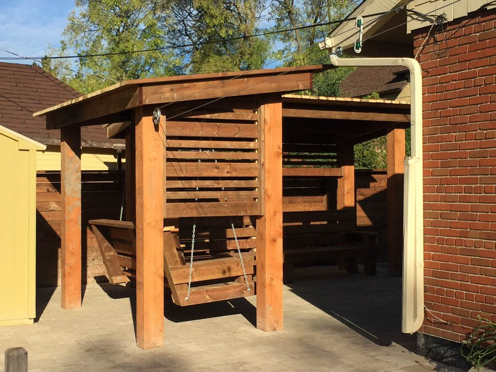 Treated Brown Pergola With Hanging Bench Fixed Bench