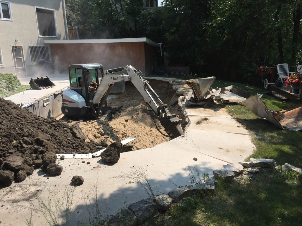 Swimming pool removal from riverbank yard