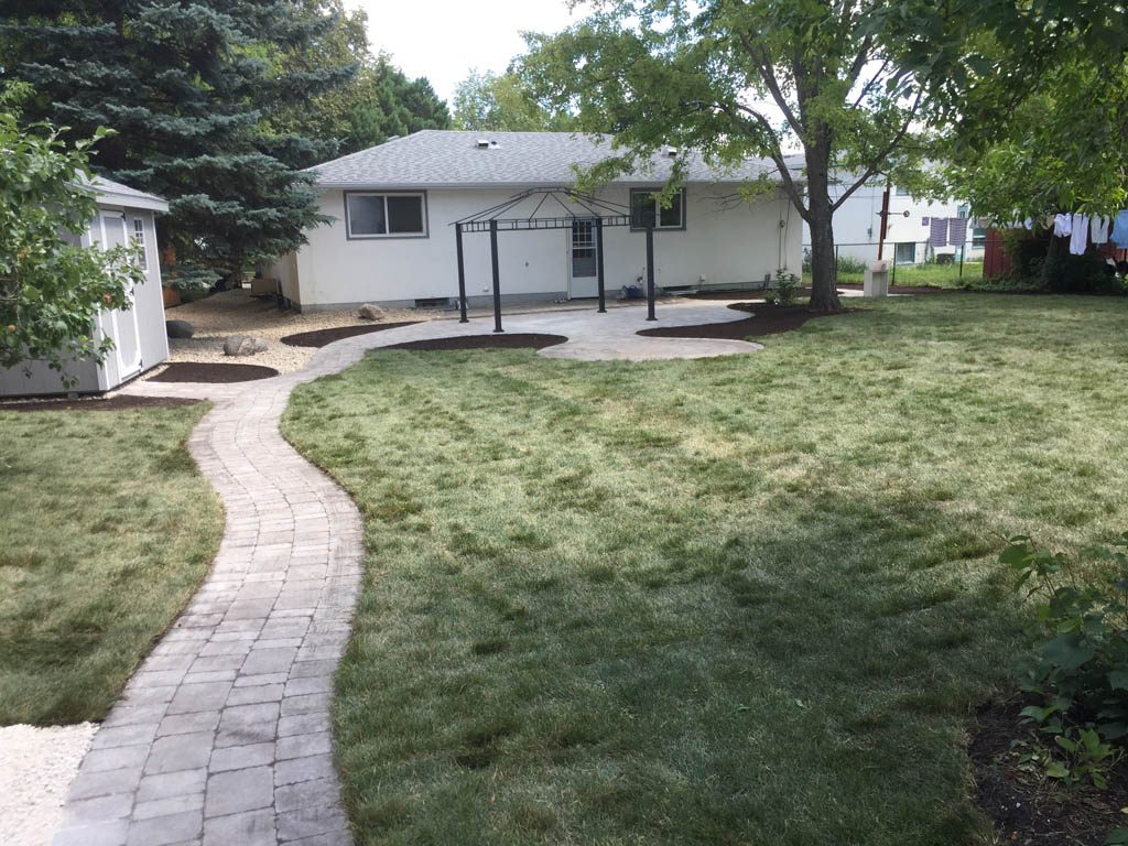 Complete yard re-grading with Roman paver walks, dry streambed, sod, etc
