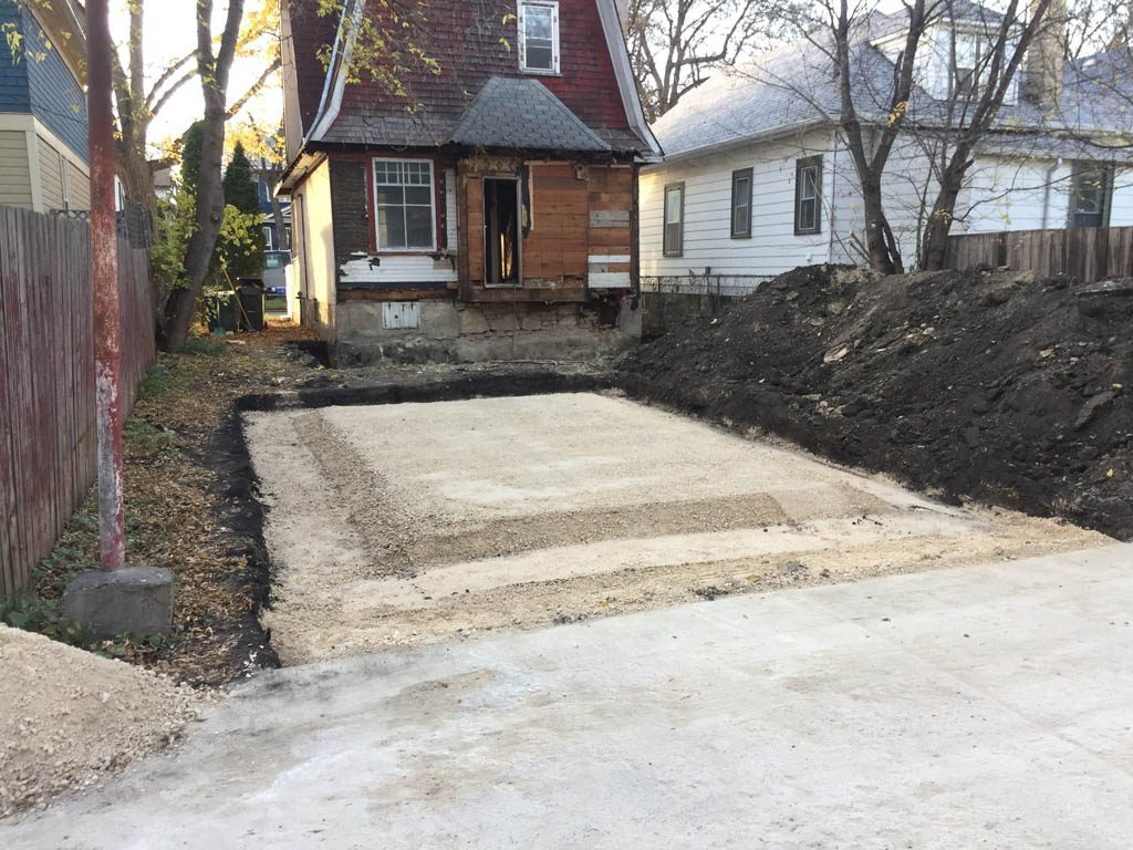 Excavation and prep work for basement expansion and garage pad