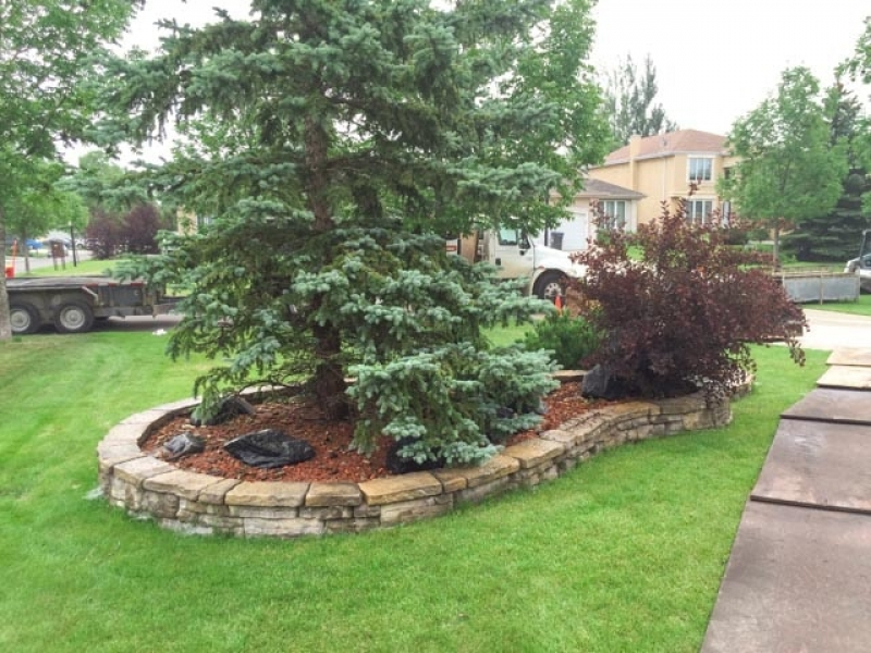 Rock garden with red shale, riverwash,fieldstone boulders, bordered with i-con edger