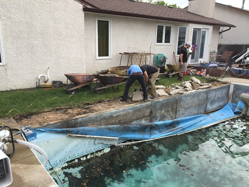 Backyard pool removal with mini excavators