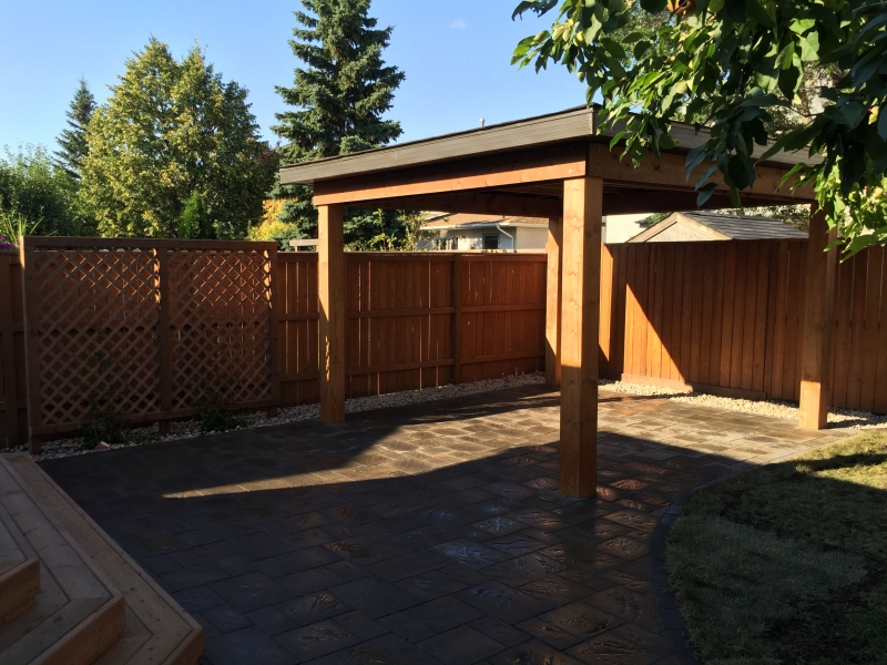 Navarro paving stone patio in Sierra Grey with treated brown stairs and gazebo roof