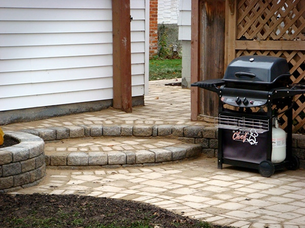 Patio and steps with Roman pavers and Roman Stack Stone retaining wall bricks