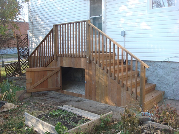Treated brown steps and landing with storage access door. (decks).jpg