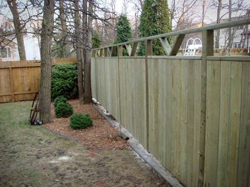 Treated green fence with custom v-shaped top insets (fence)