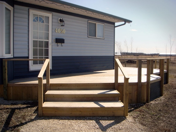Treated green front deck with 22 inch step treads. (decks).jpg