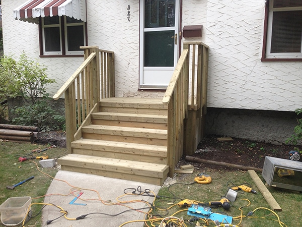 Treated green front steps with 2x4 rail and4x4 posts (decks).jpg