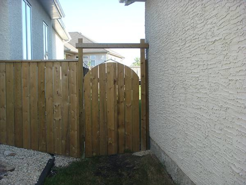 Treated green gate with rounded top and crossbar (fences)