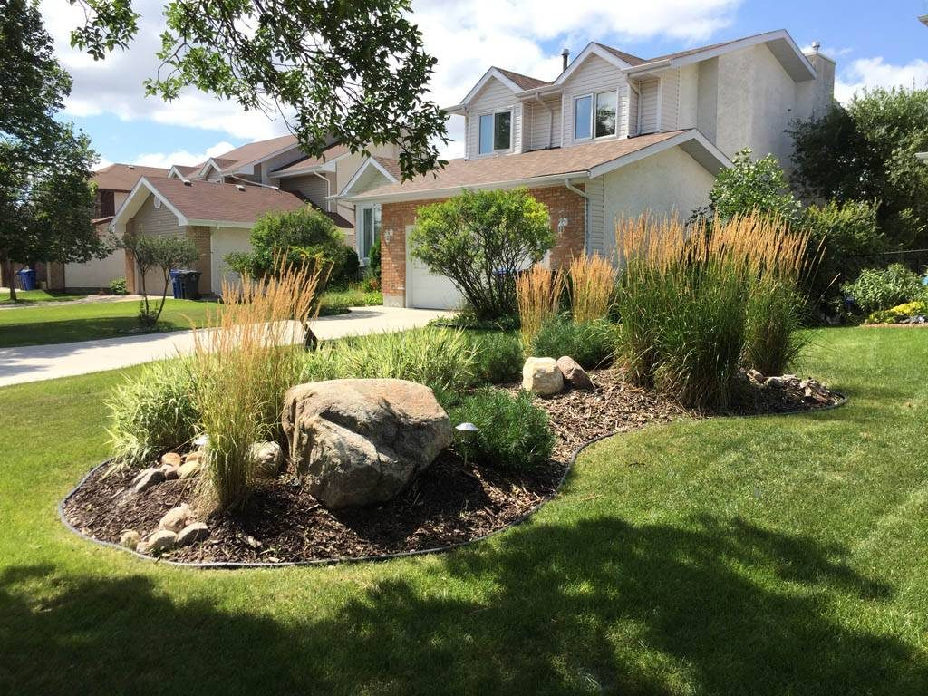 Updated - Front yard berm with round boulders, wood mulch and plants (Low maintenance gardens)