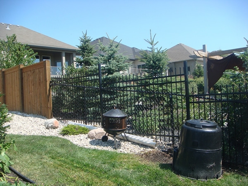 5 foot black ornamental fencing and 6 foot treated brown fencing with 6x6 posts