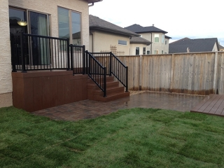 Composite deck, retaining wall window wells, patio, sod