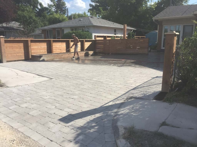 Driveway with Roman Paving Stones and Wooden Planter