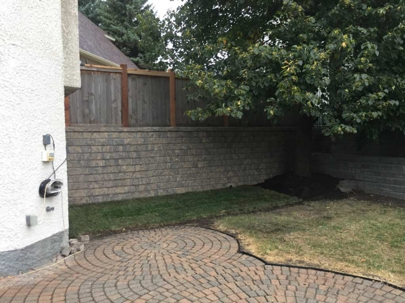 Roman Pisa Retaining Wall with Weeping Tile and Geogrid Reinforcement