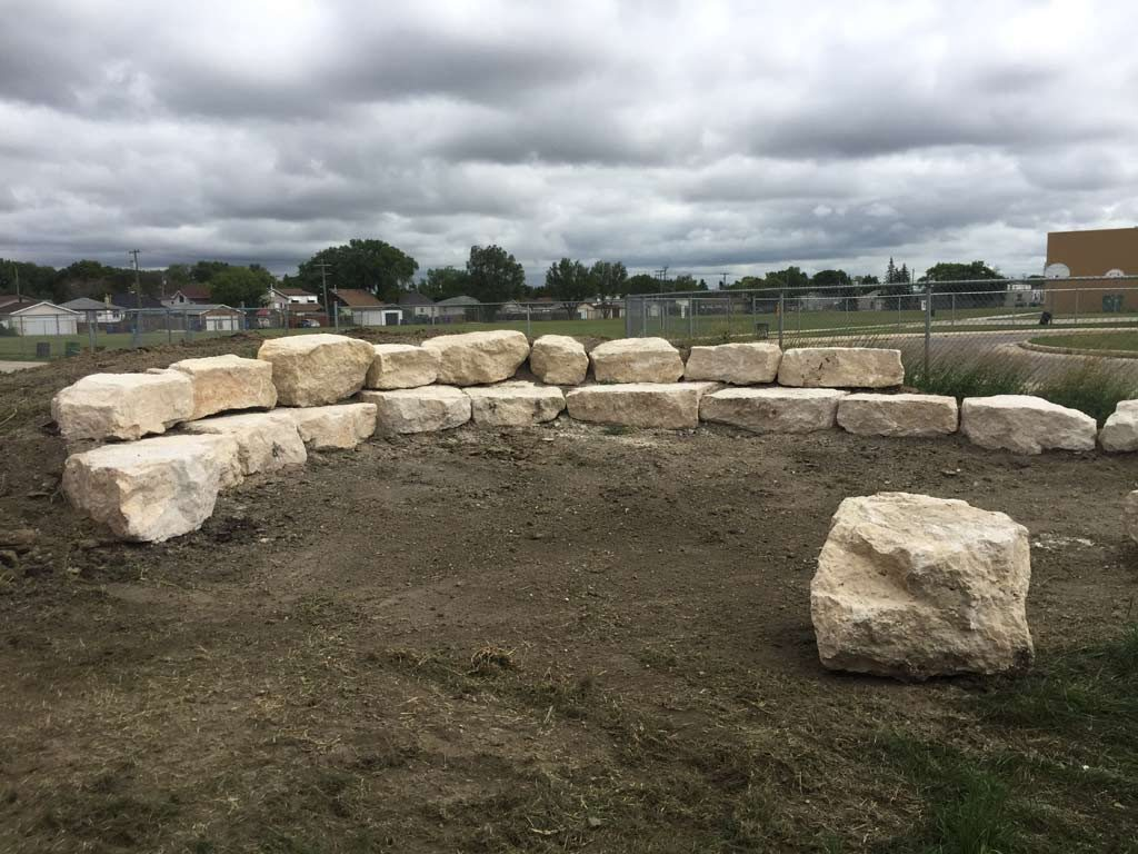 Outdoor Classroom Tiered Retaining Wall Seating with Limestone Boulders