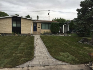 Front Yard Makeover with Roman Paver walk, Black Granite Boulders, Plants, Sod